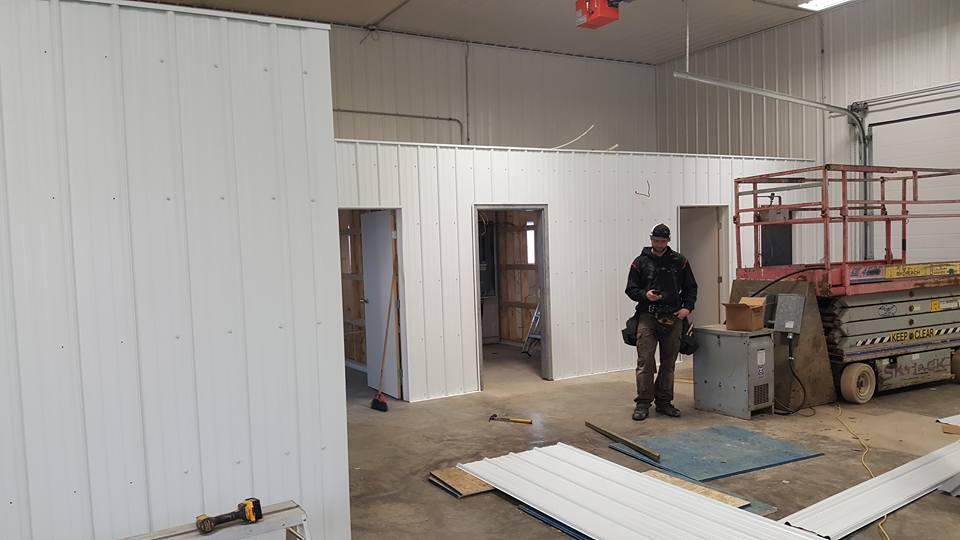 Framing up and doing metal work on interior office spaces