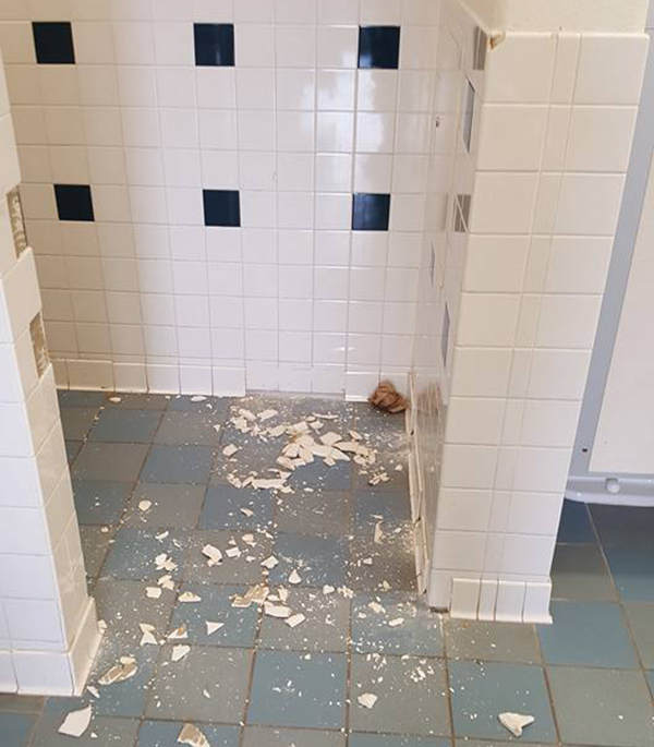 Dasher Construction replacing tile.