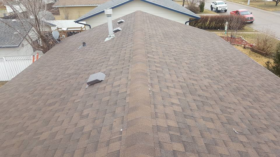 Shingles installed by Dasher Construction