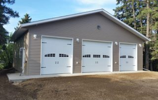 Gorgeous three car garage by Dasher Construction